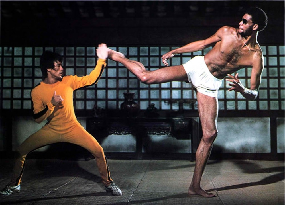 In Game of Death Bruce Lees character is an actor While filming a scene in a movie within the movie prop guns are replaced with real guns and Bruce Lees character is shot and seemingly killed